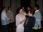 Cely Ong getting the corsage from Eleanor Evangelista