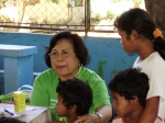 Dr. Freida Salamangcay, happy to examin one of the Mangyan patients.